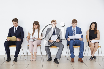 Candidates waiting for job interviews, full length, front