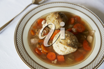 Jewish matzon ball soup served in a dish for passover