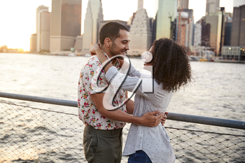 Romantic Young Couple With Manhattan Skyline In Background