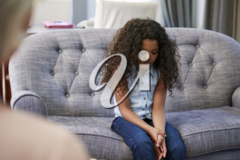 Young girl having therapy with a child psychologist