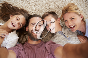 Point Of View Shot Of Parents And Children Posing For Selfie