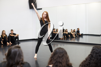 Female Student At Performing Arts School Performs Street Dance For Class And Teacher In Dance Studio