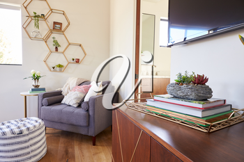 Interior Shot Of Stylish Modern Bedroom Showing Chair And En Suite Bathroom