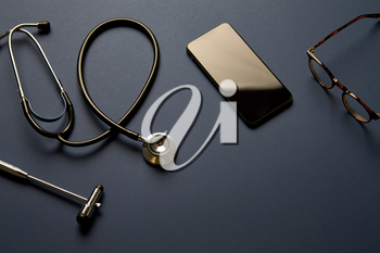 Overhead Flat Lay Shot Of Medical Equipment On Black Background