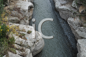 Royalty Free Photo of a River Flowing Through Rocks