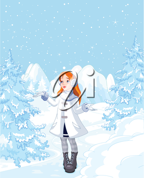 Cute Girl enjoying a winter snowfall
