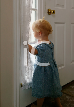 Royalty Free Photo of a Toddler Waiting at the Window