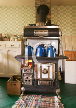 Royalty Free Photo of an Antique Cast Iron Wood Burning Kitchen Stove
