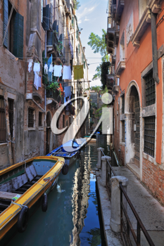 The narrow street channel. Picturesque laundry drying on clothesline. Gorgeous Venice