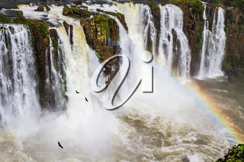 Complex of the most abounding in water Iguazu Falls in the world on border of Argentina, Brazil and Paraguay. Concept of active and extreme tourism