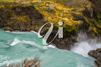 Travel to Patagonia. Turquoise water is a powerful waterfall Salto Grande. Concept of active and ecological tourism
