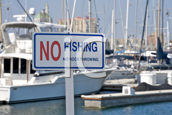 Royalty Free Photo of a No Fishing and No Rock Throwing Sign at a Marina