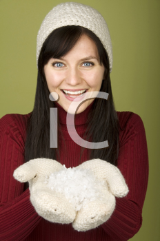 Royalty Free Photo of a Woman Holding a Mitt Ful of Snow