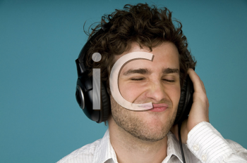 Royalty Free Photo of a Closeup of a Man Listening to Headphones