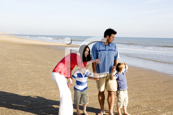 Royalty Free Photo of a Family at the Beach