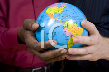Royalty Free Photo of Multi-Racial Men Holding a Small Globe