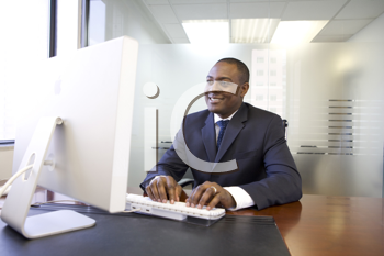 Royalty Free Photo of a Businessman at the Computer