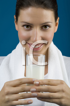 Royalty Free Photo of a Woman With a Glass Of Milk