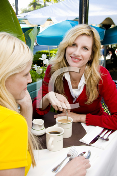 Royalty Free Photo of Two Blondes Drinking Coffee
