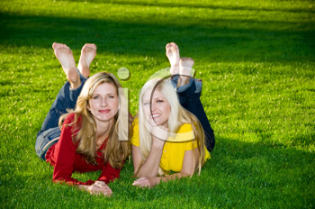 Royalty Free Photo of Two Women Lying in the Grass