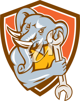 Illustration of an african elephant mascot mechanic holding spanner set inside shield crest on isolated background done in retro style.