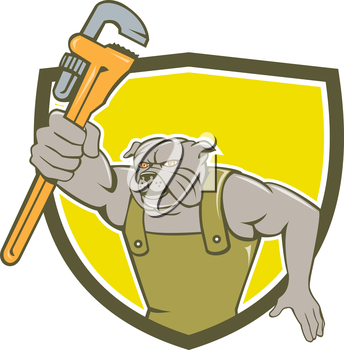 Illustration of a bulldog plumber holding monkey wrench facing front set inside shield crest on isolated background done in cartoon style.