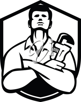 Black and White Illustration of a handyman plumber repairman worker arms folded holding monkey wrench set inside badge shield crest on isolated background done in retro style.