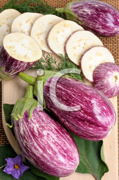 Royalty Free Photo of Sliced and Whole Eggplants