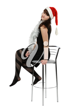 Girl with red hat on a high chair, isolated on a white background.