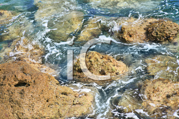 The rock on seashore with blue water (hdr)