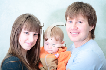 Excited happy young family of three person