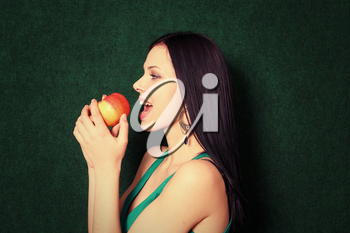 women playing with apple near face