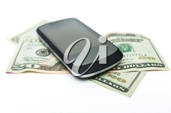 mobile phone and money on white