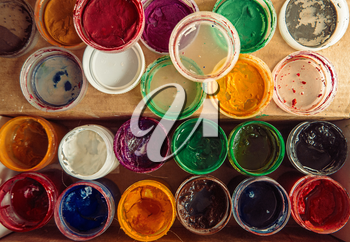 Gouache paint jars. Tools for creative work. Paintings Art Concept. Above view.