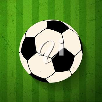Football on a green striped grunge background
