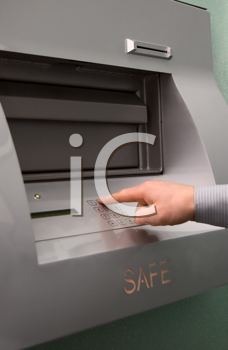 Royalty Free Photo of Someone Entering the Safe By Keypad