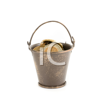 bucket full of coins isolated on a white