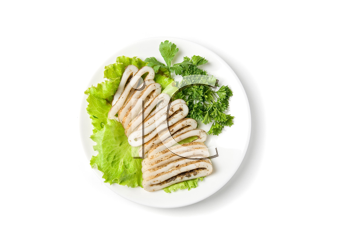sliced squid and green vegetables dish isolated on white