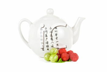 Royalty Free Photo of a Teapot and Berries