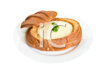 Cheese soup at baked bread as plate on a white background