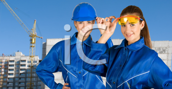 Royalty Free Photo of Female Builders on a Building Background