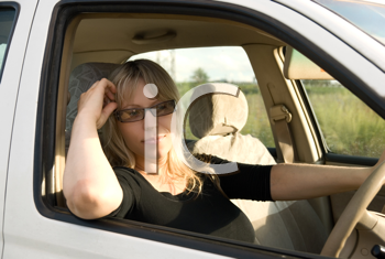 Royalty Free Photo of a Woman Driving a Car