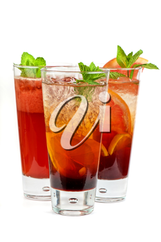 Set of fresh cold tea with fruits, berries and ice on white