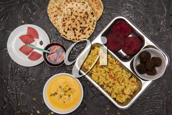 Vegetarian food: pea soup, pilaf, flat cakes, beet cutlets, pumpkin seeds and compote of pickled pears