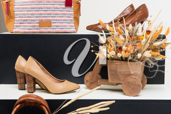 Set handbag, shoes and bouquet of dried flowers