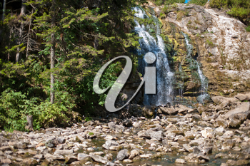 Waterfall in summer siberian forest