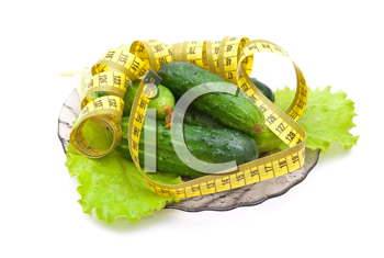 Cucumbers with a measuring tape