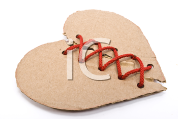 Torn cardboard heart with red shoelace