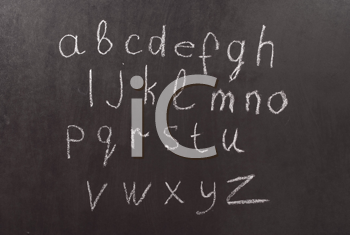 Royalty Free Photo of the Alphabet on a Chalkboard
