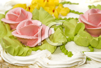 Dessert - Close-up of cake with cream, pink roses and green leaves